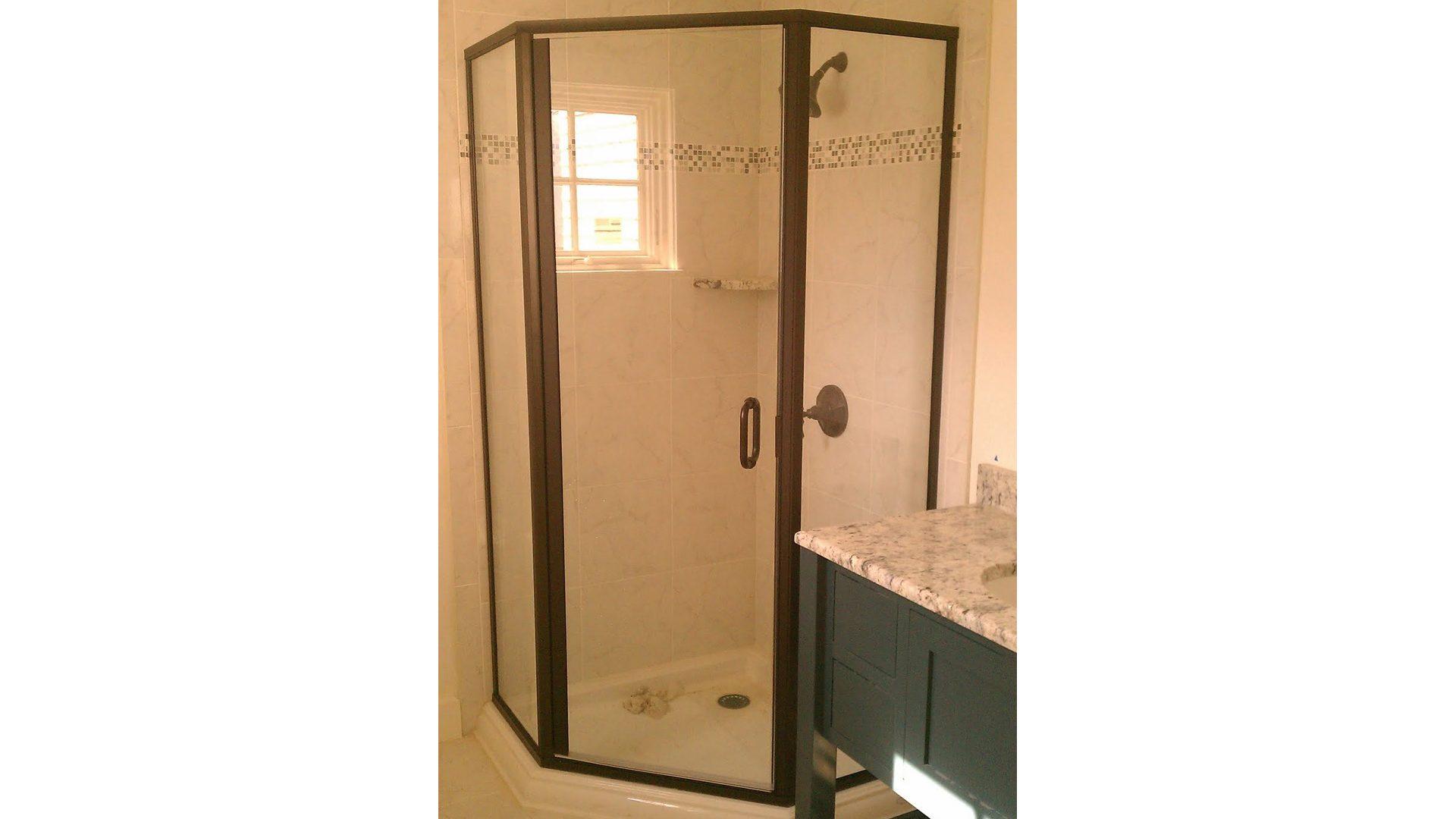 brass framed neoangle shower doors