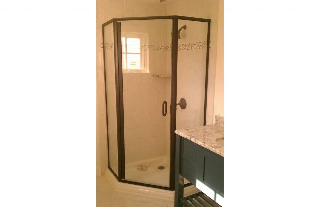 brass framed neoangle shower doors