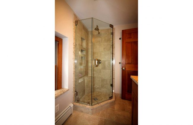 Frameless NeoAngle Shower Door in Lakeville