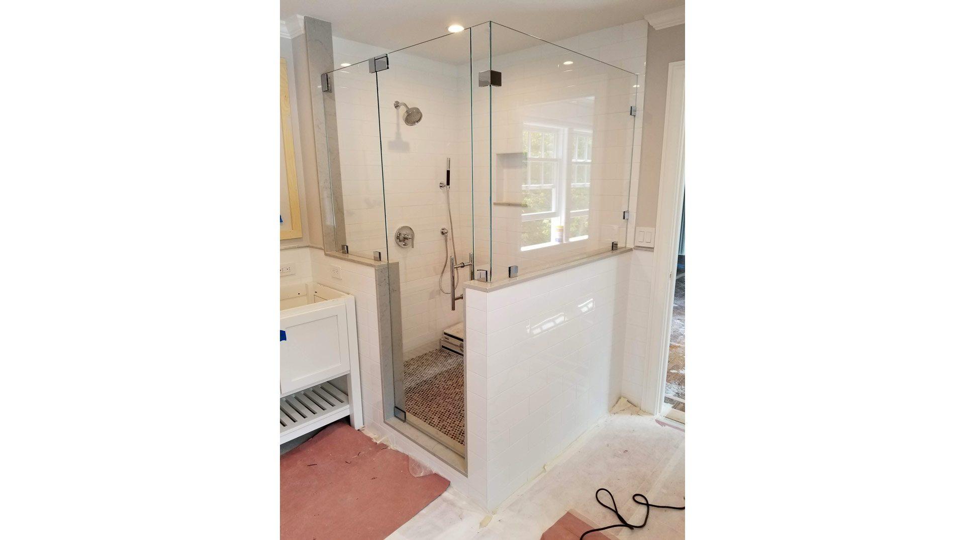 frameless walk-in shower enclosure in Milton